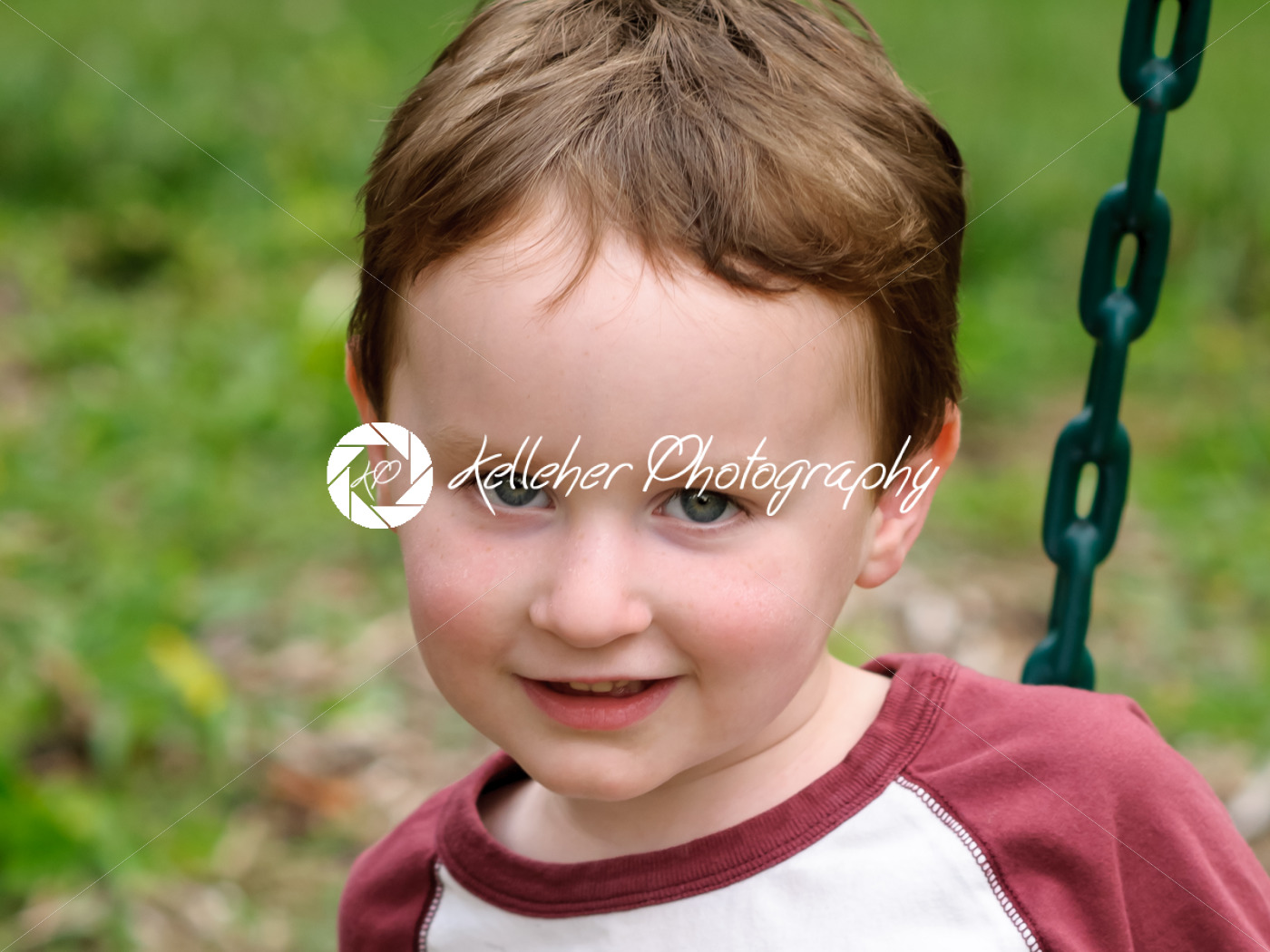 Young boy having fun on a swing - Kelleher Photography Store