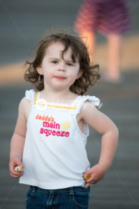 Young cute little girl on the boardwalk looking ahead - Kelleher Photography Store