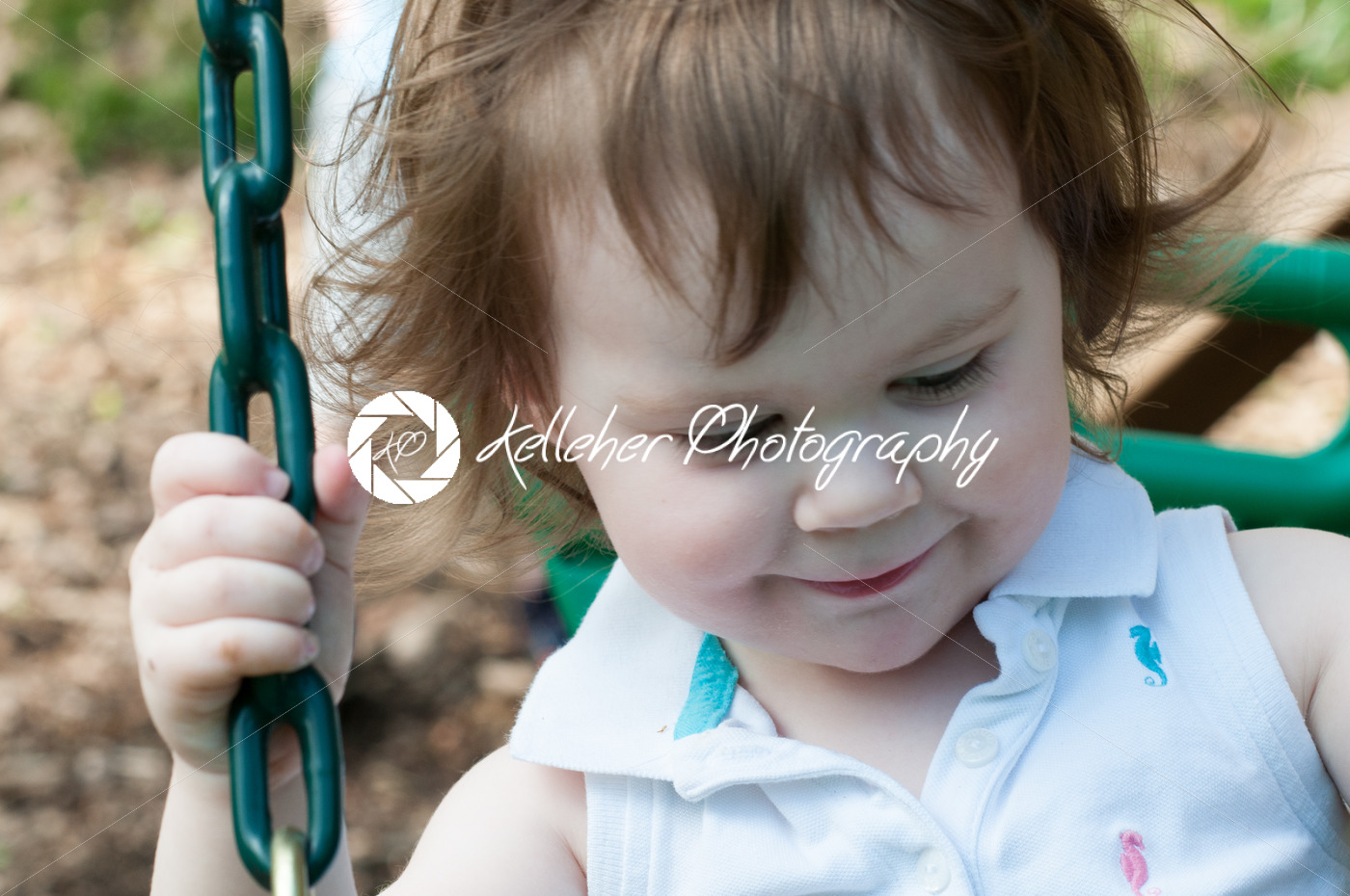 Young girl having fun on a swing - Kelleher Photography Store