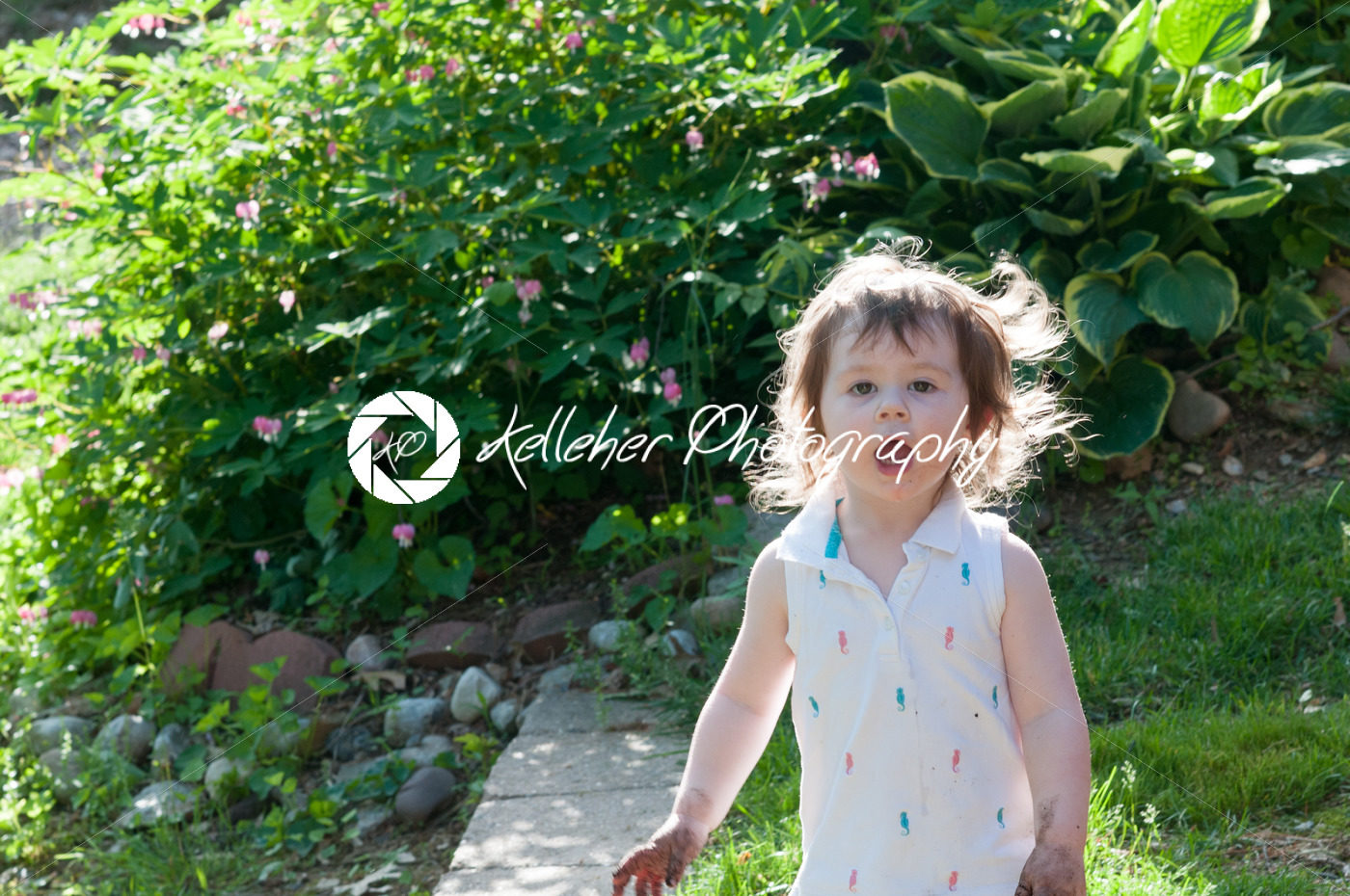 Young girl having fun outdoors in the back yard - Kelleher Photography Store
