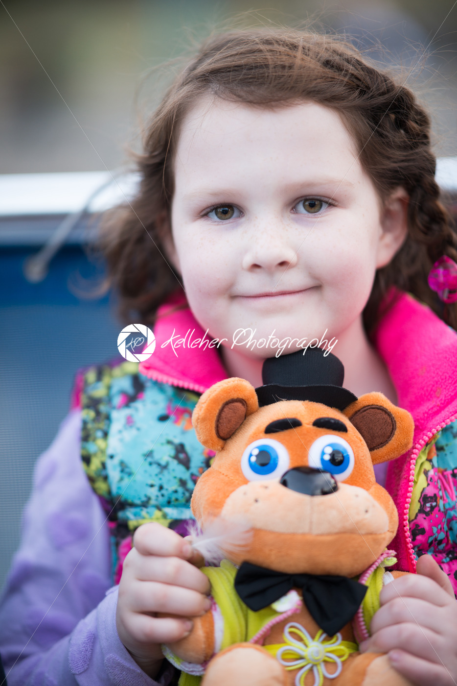 Young girl outside on boat looking happy - Kelleher Photography Store