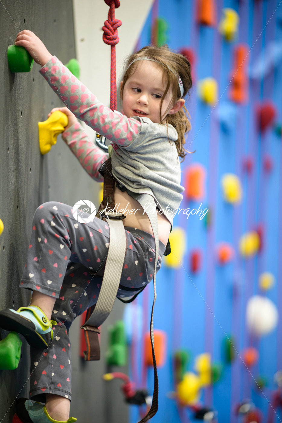 little girl climbing a rock wall indoor - Kelleher Photography Store
