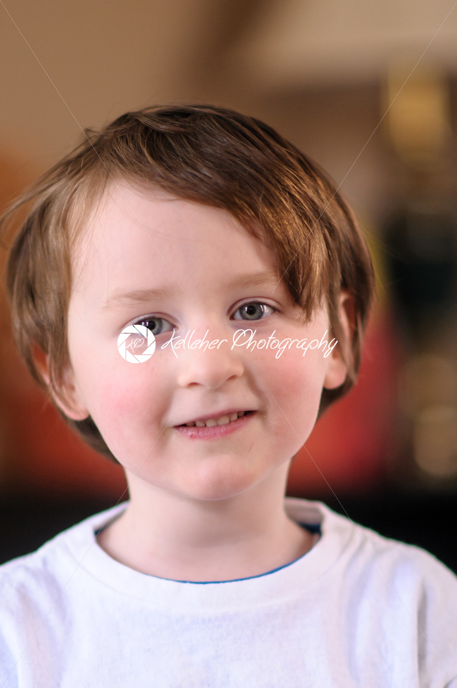 Portrait of a cute little boy smiling Indoors - Kelleher Photography Store