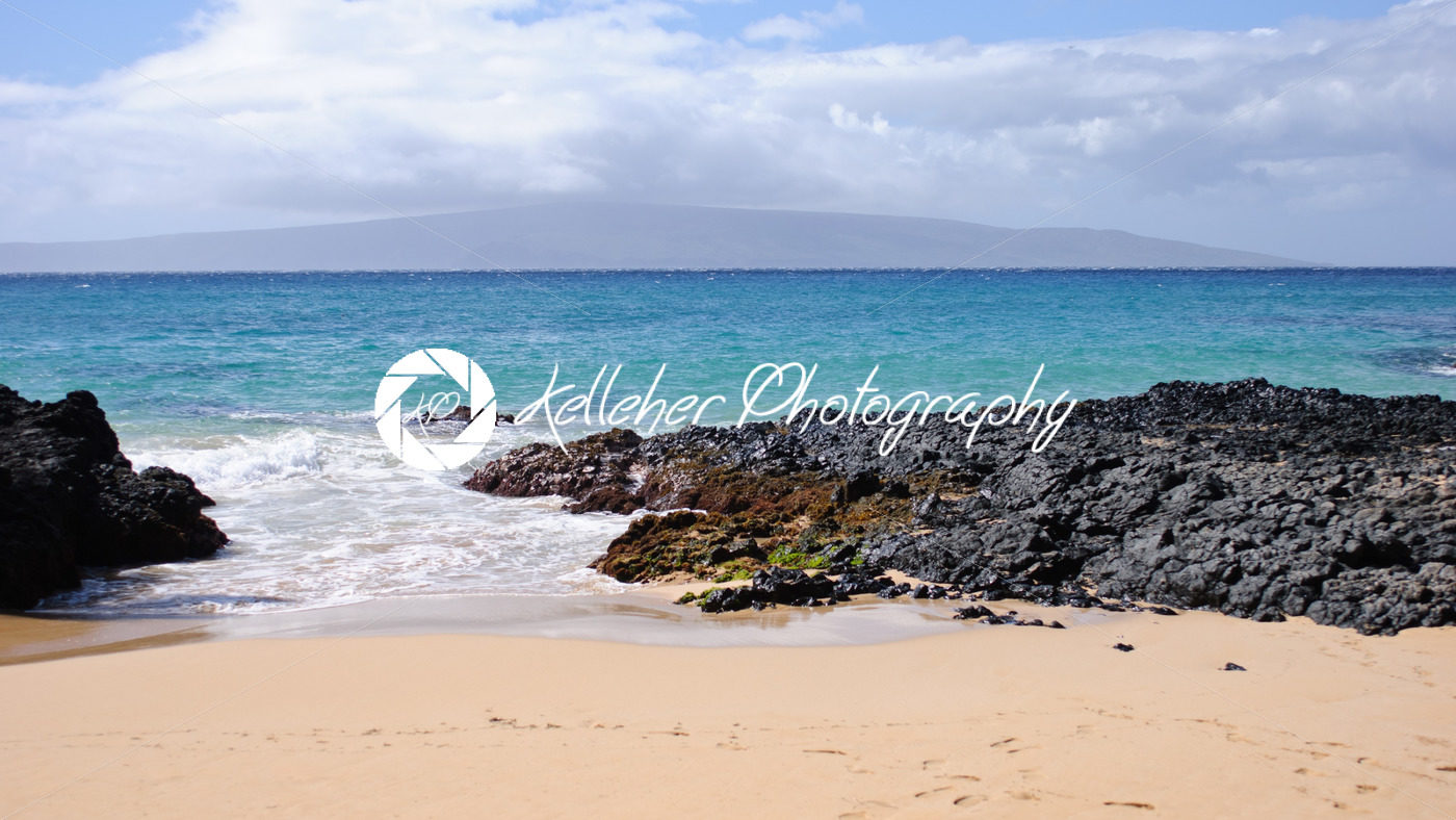 Private Beach With Sand And Lava Rocks In Maui Hawaii