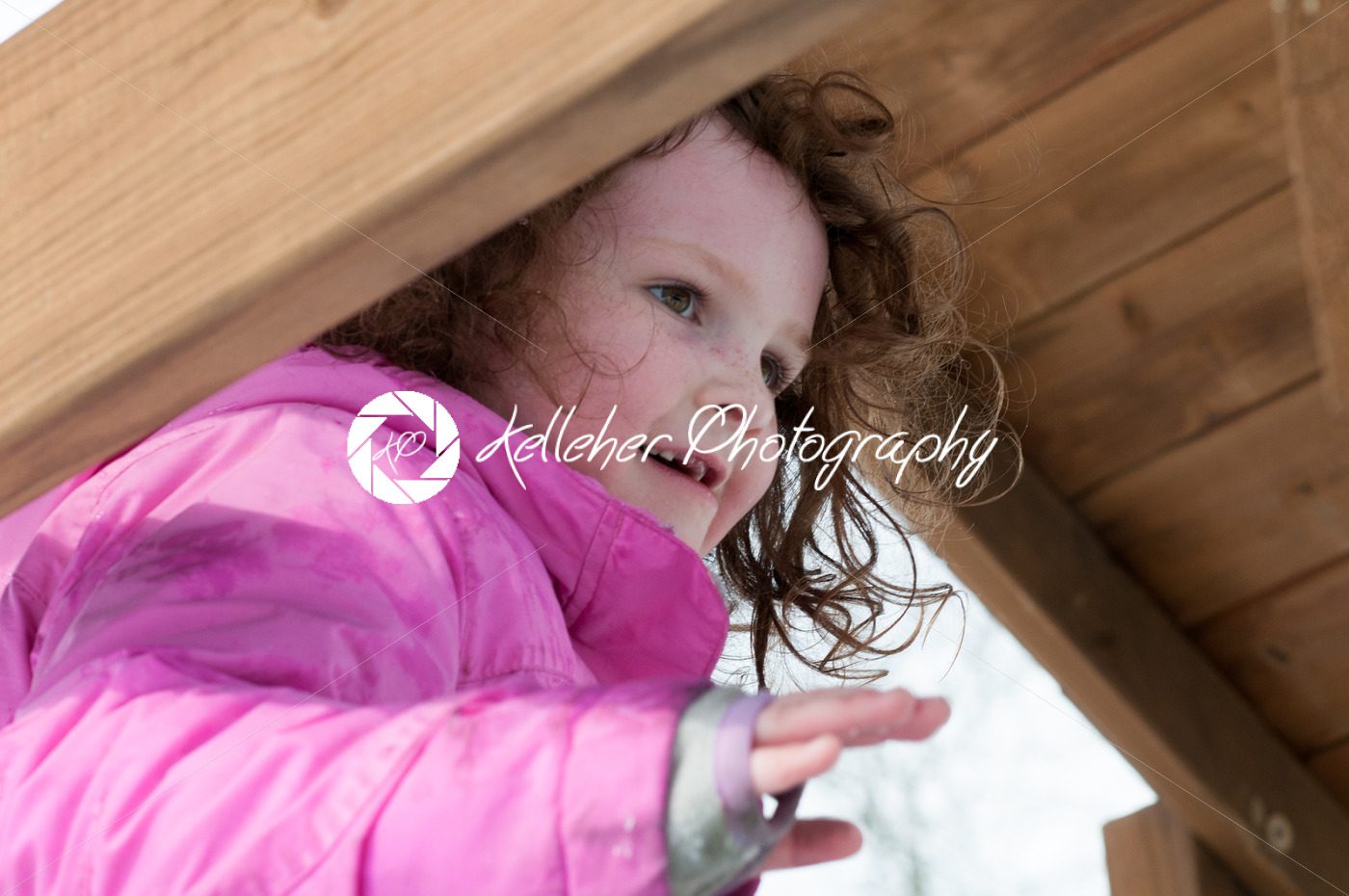 Happy toddler girl in warm coat on on snow day and having a fun in the winter outside, outdoor portrait - Kelleher Photography Store