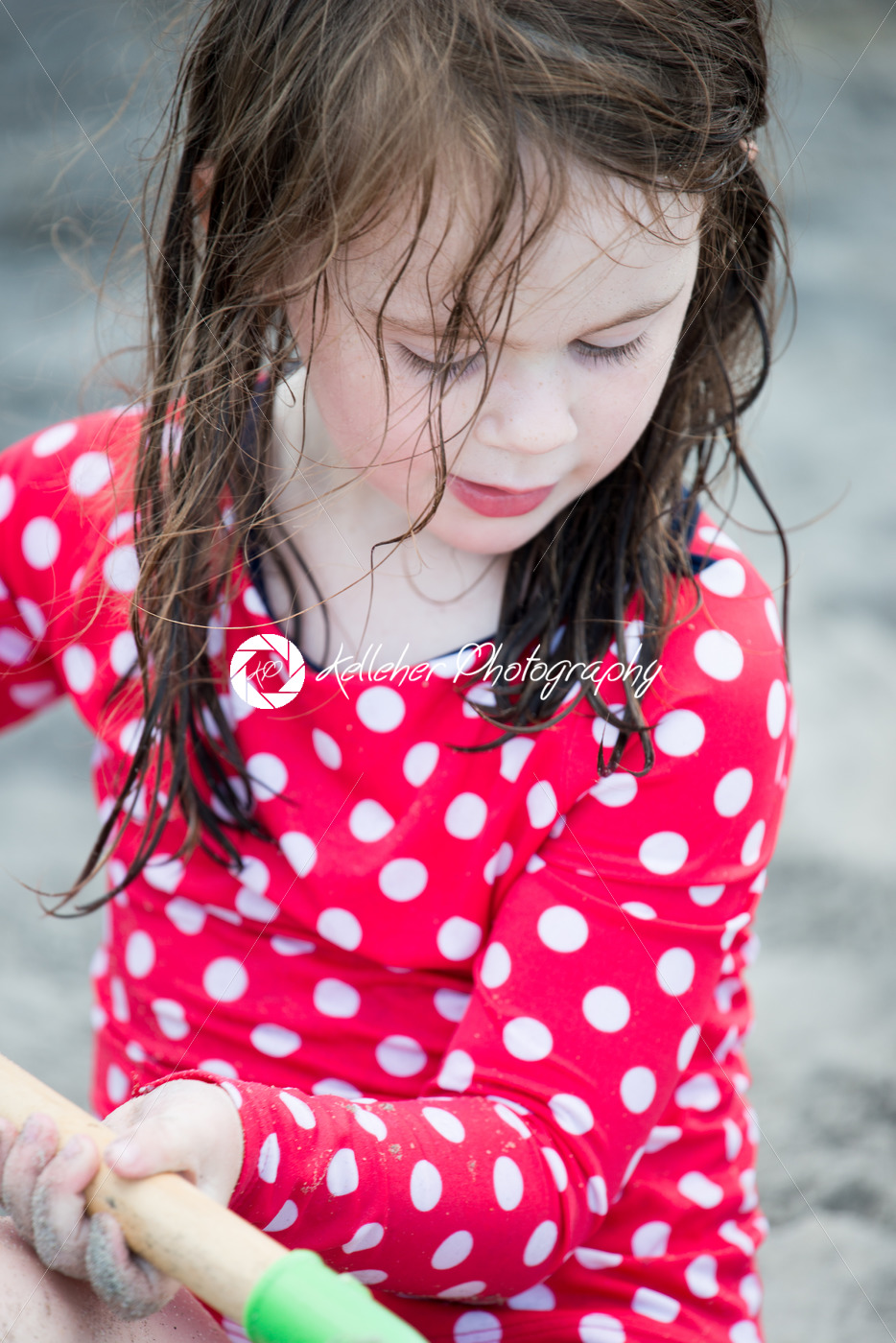 yound toddler girl having fun digging in the sand at the beach - Kelleher Photography Store