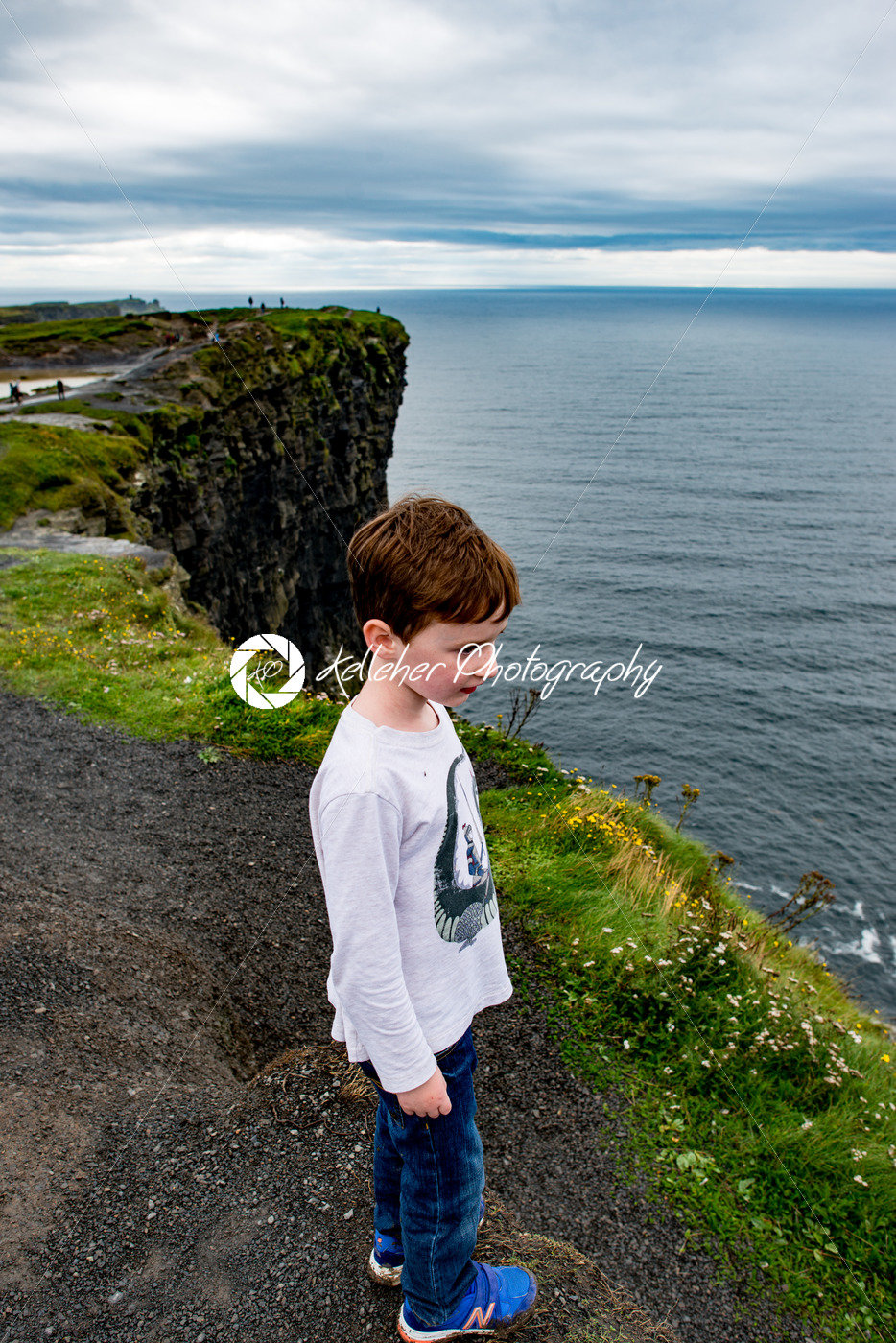 Boy looking out up the Cliffs of Moher Tourist Attraction in Ireland - Kelleher Photography Store