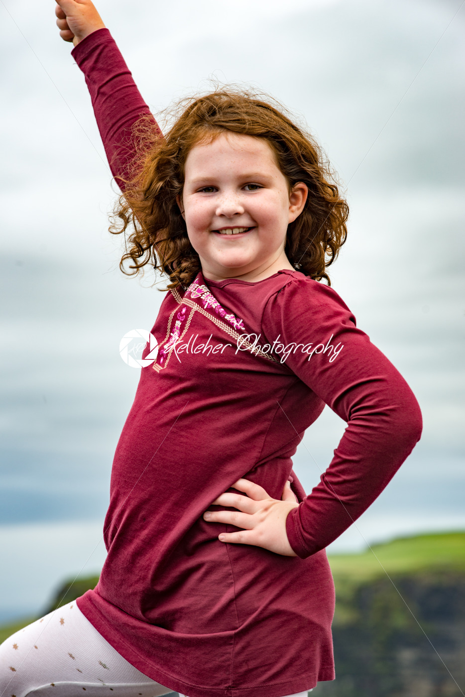 Girl at the Cliffs of Moher Tourist Attraction in Ireland - Kelleher Photography Store