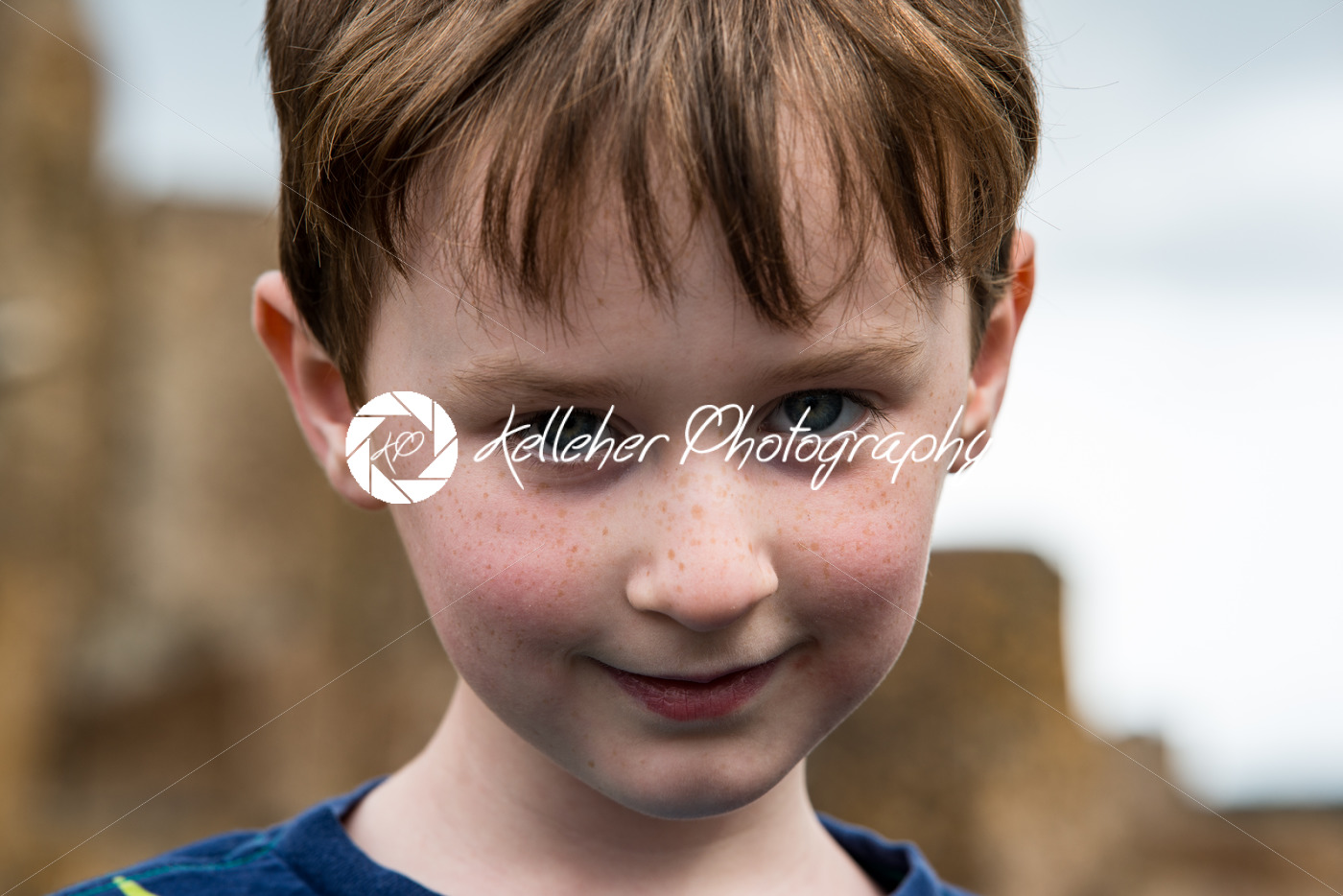 Young little boy portrait looking and smiling at the camera. - Kelleher Photography Store