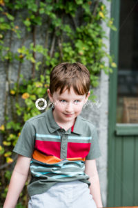 Young little boy portrait sitting down looking at camera - Kelleher Photography Store