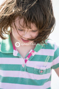 Young little girl on beach playing in the surf - Kelleher Photography Store
