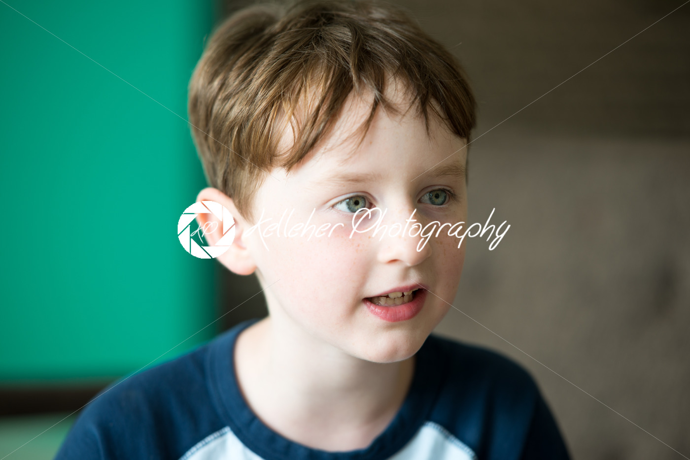 Close-up portrait of a cute boy with blue eyes - Kelleher Photography Store