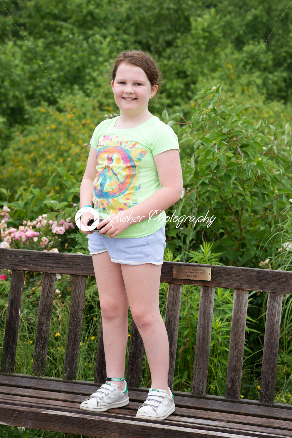 Young Pre Teen Girl Female Woman Torso Vertical Format: Preteen Smiling Girl Standing On Wooden Bench
