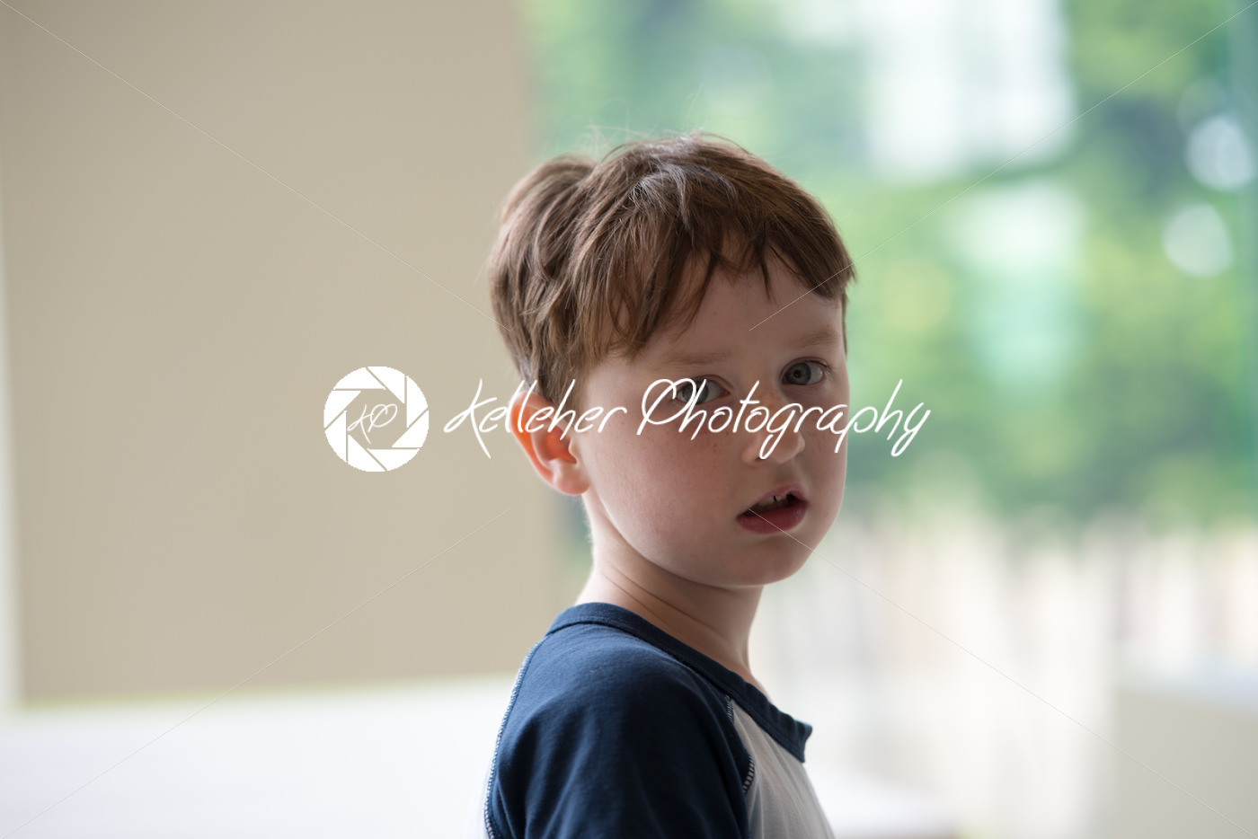Young boy looking back at camera - Kelleher Photography Store