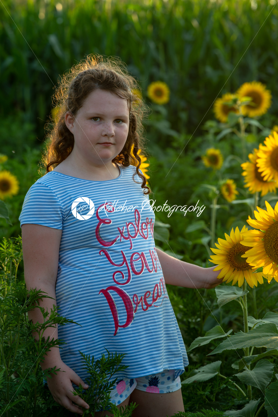 Beauty joyful young girl with sunflower enjoying nature and laughing on summer sunflower field. Sunflare, sunbeams, glow sun. Backlit. - Kelleher Photography Store