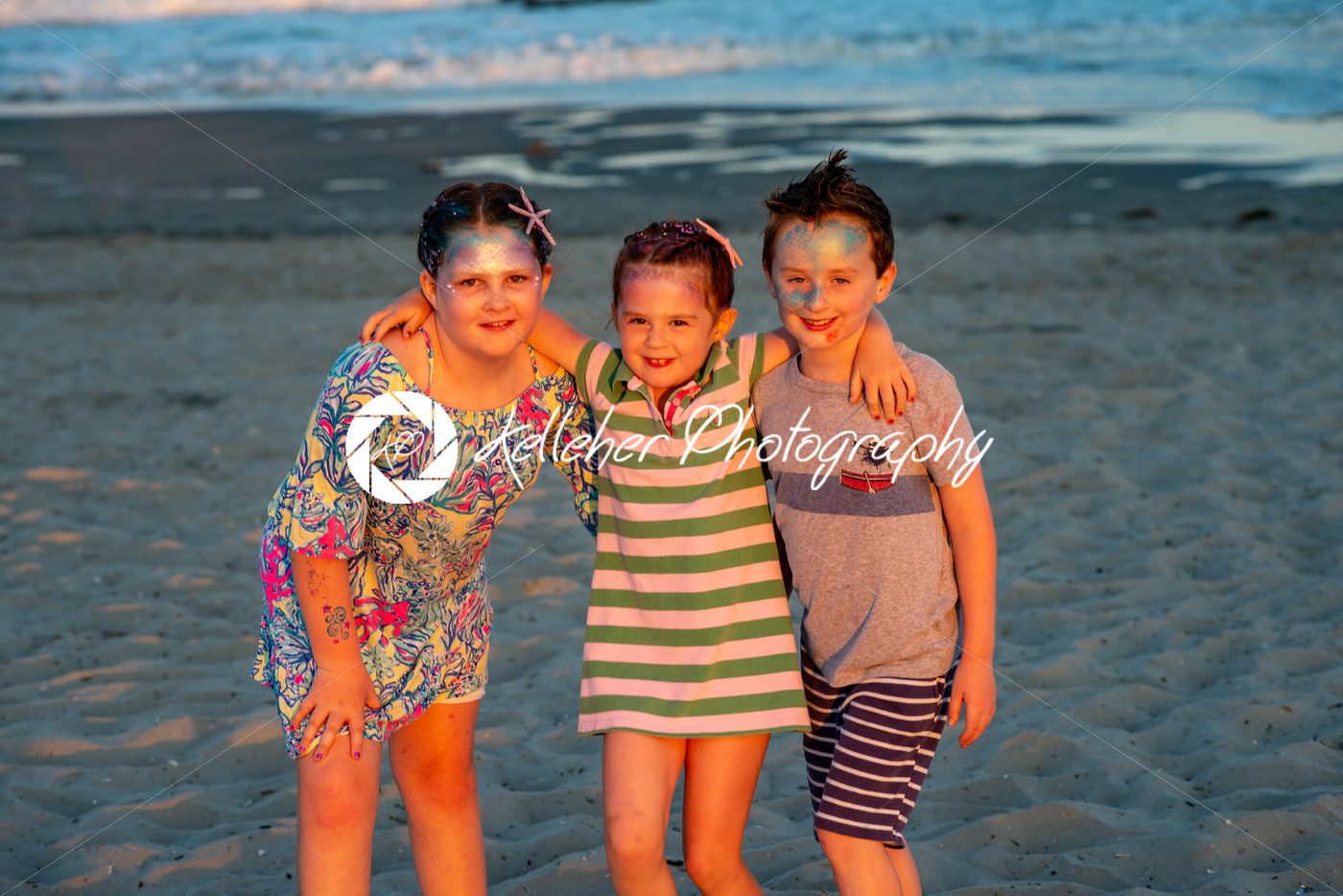 Brother and sisters on beach at sunset during the golden hour - Kelleher Photography Store