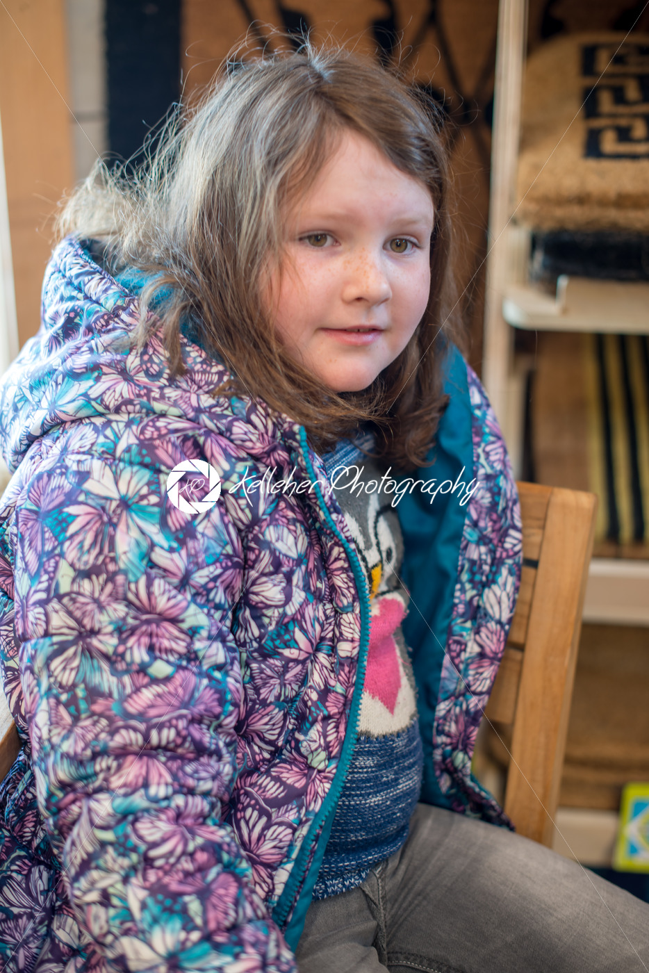 Pretty young girl sits in chair all dressed up for Easter holidays - Kelleher Photography Store