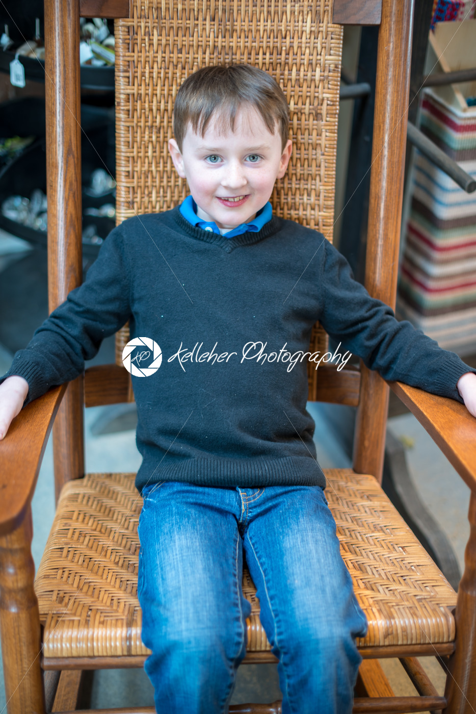 handsome young boy sits in chair all dressed up for Easter holidays - Kelleher Photography Store