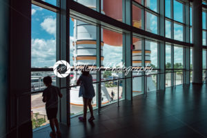 Cape Canaveral, Florida – August 13, 2018: Kids looking out at Atlantis Space Shuttle Rocket Booster at NASA Kennedy Space Center - Kelleher Photography Store