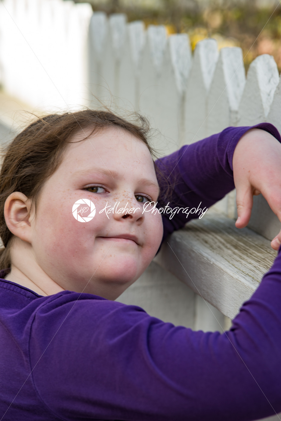 young girl posing leaning on picket fence - Kelleher Photography Store