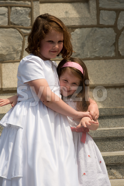 VILLANOVA, PA - MAY 14: Young Girl dressed up receiving her First Holy Communion at St. Thomas of Villanova Church Stock Photo