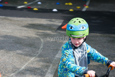 Young Boy Riding Bike on paved trail Stock Photo