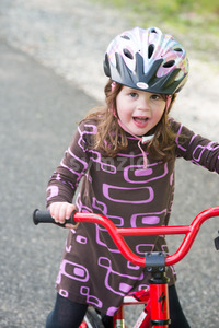 Young Girl Riding Bike on paved trail Stock Photo