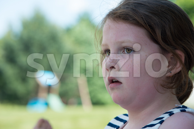 Close Portrait of Young Girl Looking Concerned Outside Stock Photo