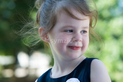 Close Portrait of Happy Young Girl Outside Stock Photo