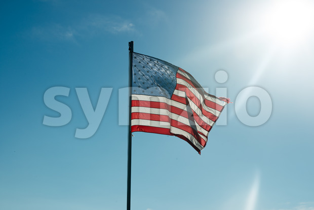 Flag of the United States of America with sunflare Stock Photo