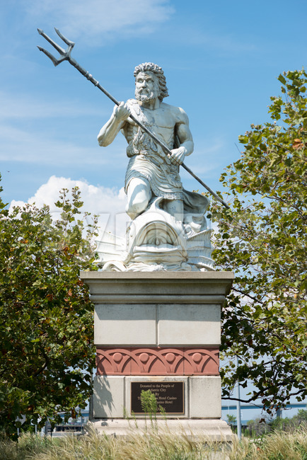 A view of a large public statue of King Neptune that welcomes all to Atlantic City Aquarium in New Jersey