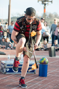BALTIMORE INNER HARBOR, MD - FEBRUARY 18: Street performer entertains crowd with juggling act on February 18, 2017 Stock Photo