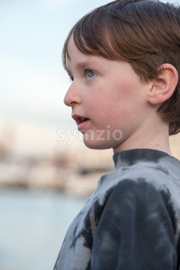 Young boy looking off into the distance Stock Photo