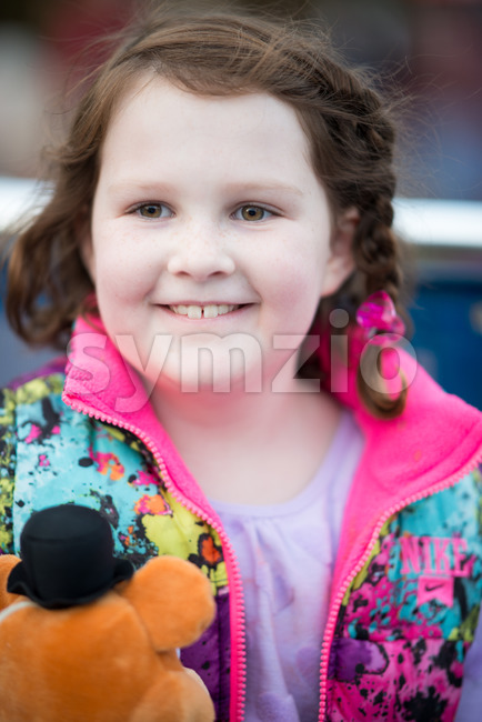 Young girl outside on boat looking happy Stock Photo