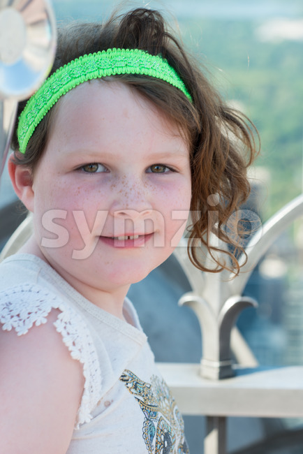 Beautiful young girl on observation deck overlooking the lower Manhattan New York City skyline Stock Photo