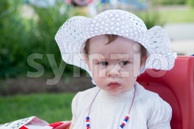 Infant Toddler Girl dressed as Betsy Ross for Fourth of July Parade Stock Photo