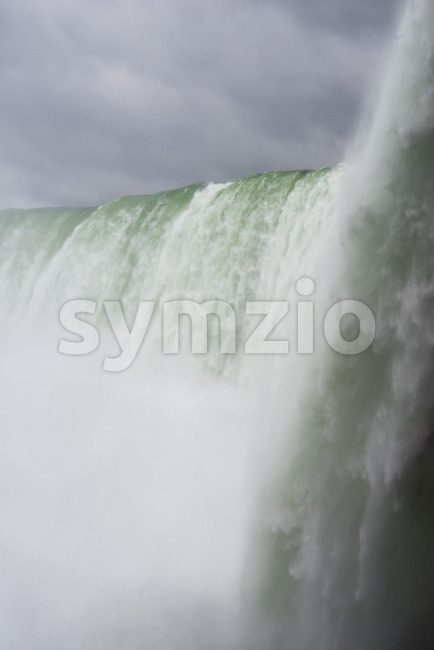 Niagara Falls on a cloudy overcast day with perfect clouds. View from Canadian side. View from below. Stock Photo