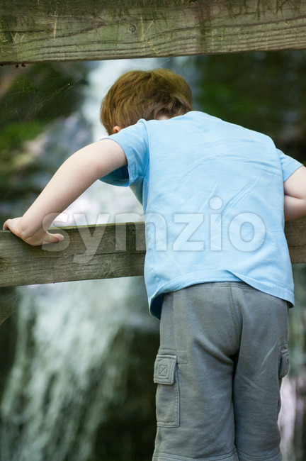 Boy looking at Crabtree Falls along the Blue Ridge Parkway near Asheville North Carolina Stock Photo