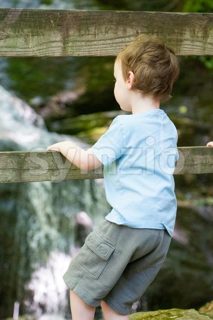 Boy looking at Crabtree Falls along the Blue Ridge Parkway near Asheville North Carolina Stock Photo