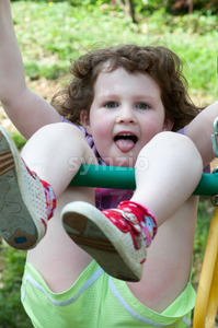 Young girl having fun on a swing Stock Photo
