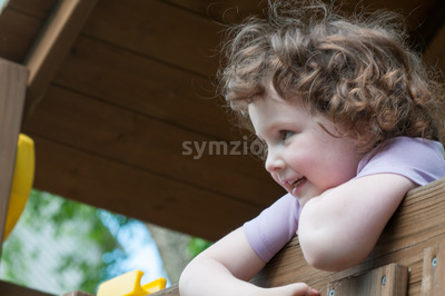 Young girl having fun on a swing set Stock Photo