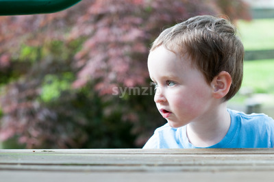 Young boy having fun on a swing set Stock Photo