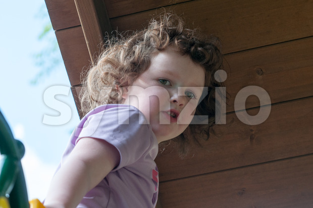 A Young girl having fun on a swing set
