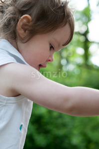 Young girl having fun outdoors in the back yard Stock Photo