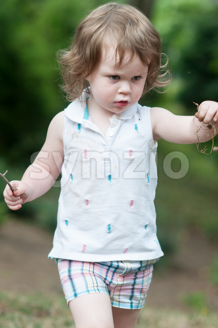 Young girl playing outside in back yard Stock Photo
