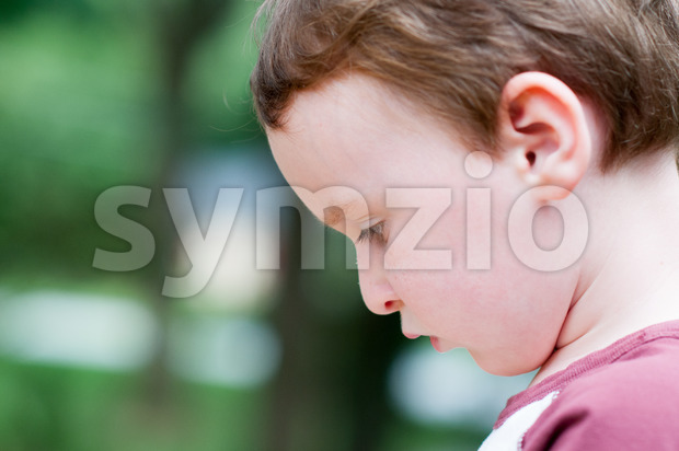 Young boy playing outside in back yard Stock Photo