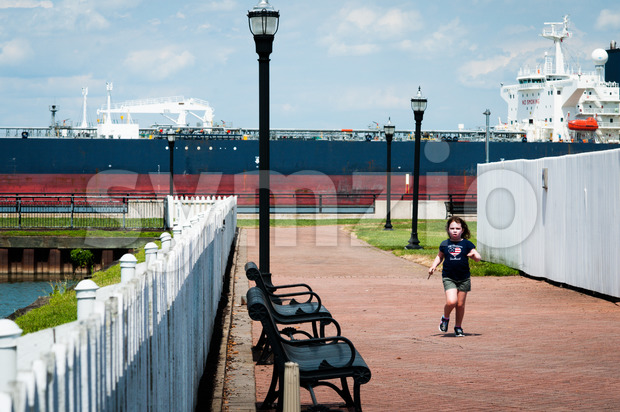 DELAWARE CITY, DE - AUGUST 1: Oil tanker ship coming into port on Delware river on a background of blue sky on August 1, 2015 Stock Photo