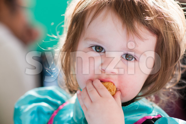 View of Close up Portrait of young girl eating