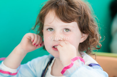 Close up Portrait of young girl eating Stock Photo
