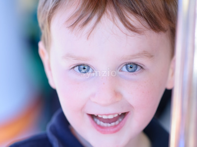 Close up Portrait of young boy outside Stock Photo